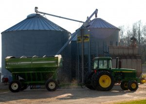 Dust particles from grain fill the air around the unloading station