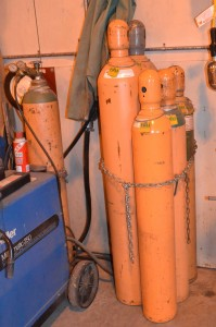 colored image of compressed gas canisters in a shop