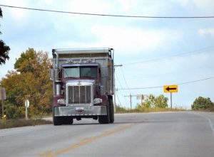 A color photo of an Ag CMV operating on a road. These farm vehicles may be eligible to use dyed fuels.