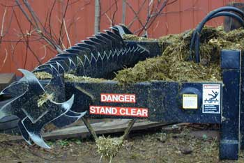 "A color photo of a silage defacer with warning signs ""DANGER - Stay Clear"""