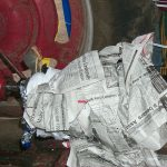 A power take off shaft wrapped in newspaper as part of a demonstration on power take-off safety.