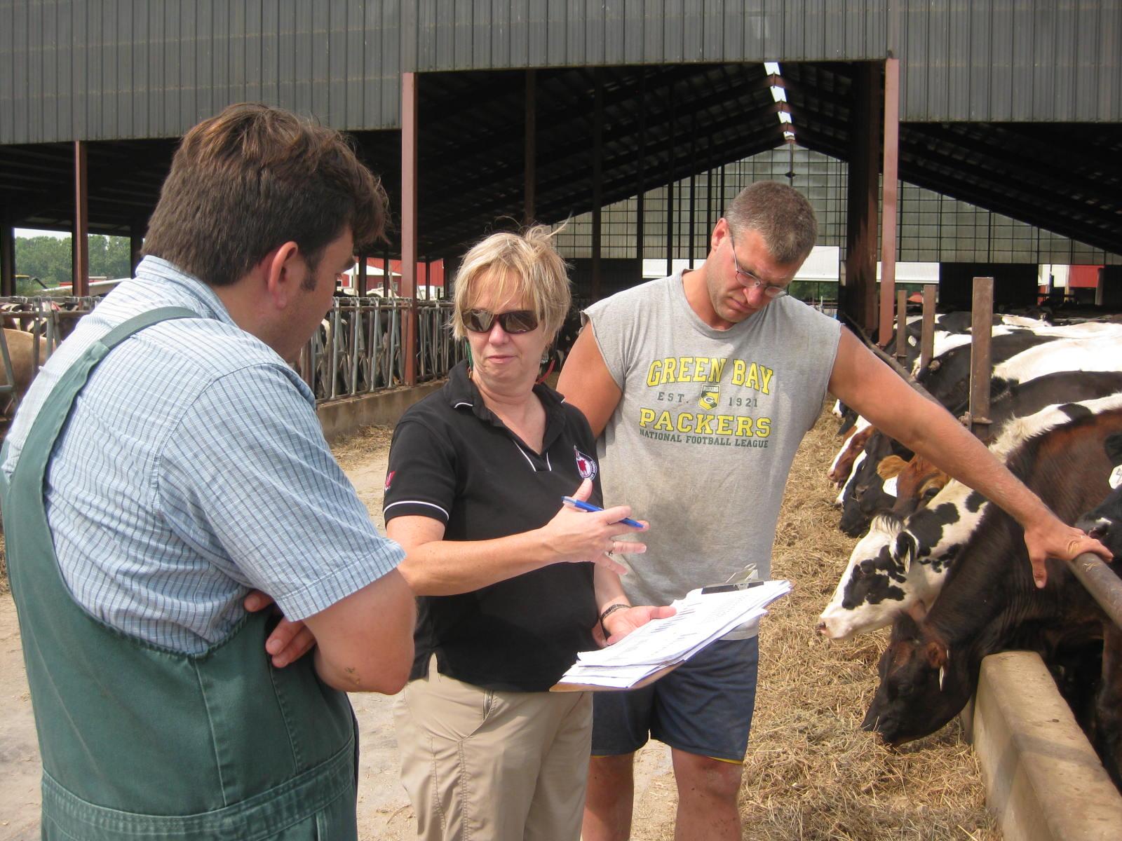 image of Sarah Mills-Lloyd, Pamela Ruegg, and the vet