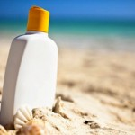 bottle of sunscreen on a beach