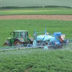 crop spraying with tractor