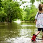 flooded street with child in rain boots