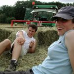 female farmer with hay and baler