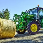 tractor with round hay bale