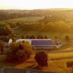 farm with solar array on barn