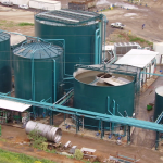 Image of a teal green digester