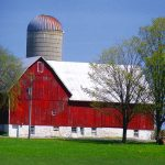 picture of a red barn & gray silo