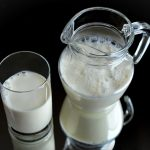glass and pitcher of milk