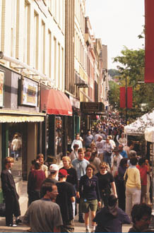 People walking down a crowded mainstreet