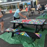 people painting picnic table