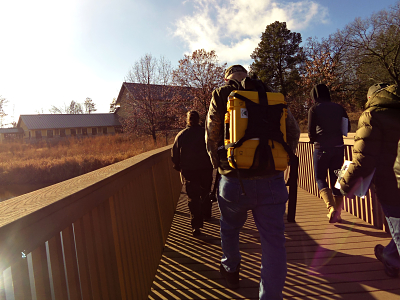 Group carrying DOTS kit across bridge