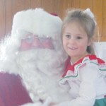 ANDEE ROWE, of Montreal, Wis., hugs Santa Claus during the annual Gurney Gopher 4-H Club's pie social in Gurney, Wis., on Saturday.
