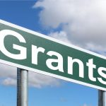 grants written on a green roadsign