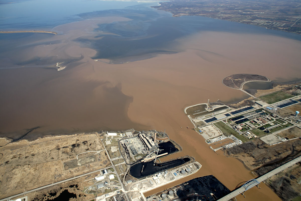 Photo courtesy of Great Lakes Inform. Sediment, nutrients, and pollutants from the Fox River flowing into southern Green Bay.