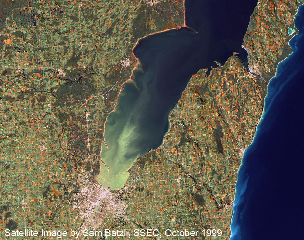 Light green on aerial shot indicates algae bloom on the bay of Green Bay and Lower Fox River