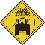 Road sign with farm tractor and road indicating new rules.