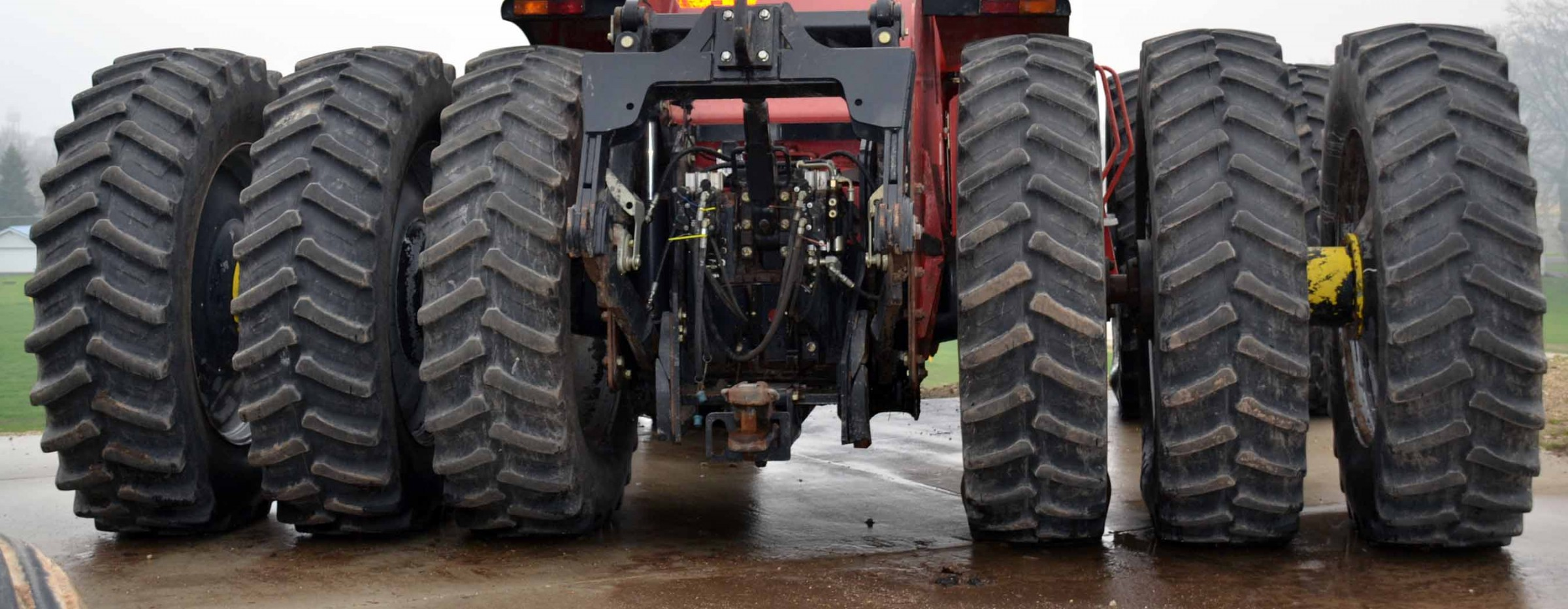 A color photo of a farm tractor with triple tires on rear axles.