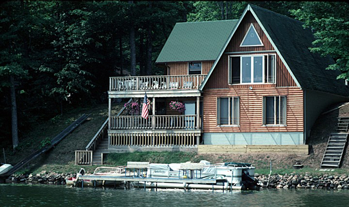 house next to water's edge