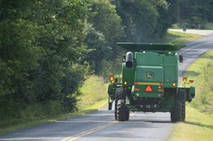 combine driving down road