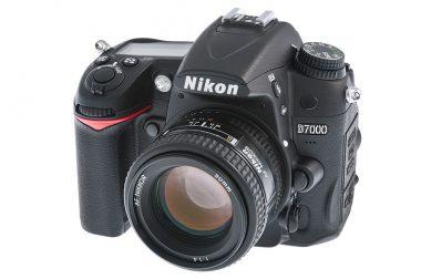 Nikon D7000 camera on white background.