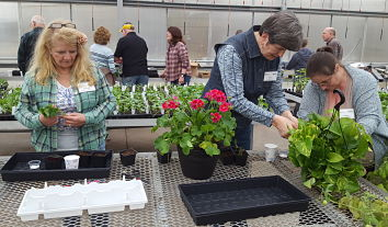Master Gardener students learning about plant propagation in the Montello High School greenhouse.