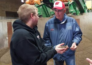 individuals discussing manure handling options