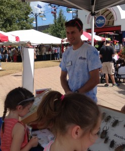 PJ Liesch talks with Wisconsin State Fair-goers about bugs in Wisconsin. Visit the Insect Experts booth at Wisconsin Farm Technology Days to identify Wisconsin bugs.