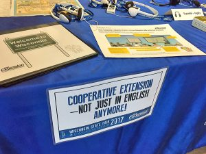A display table exhibits several language access materials.