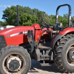 A color photo of a CASE farm tractor with an open operator's platform and folding ROPs.