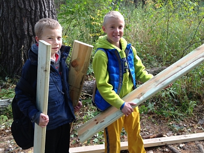 Two boys holding deck boards