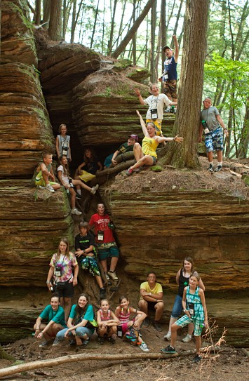 Group youth photo in front of sandstone cliff