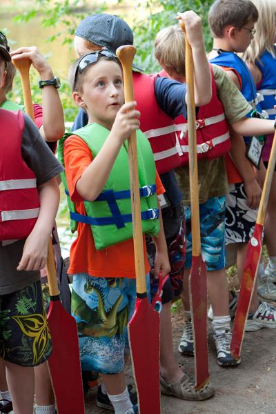 Child holding canoe paddle