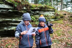 Boys holding digital weather reader