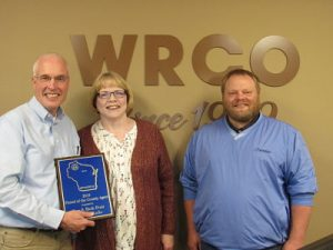 Ron & Beth Fruit being presented the Friend of the County Agent Award by Adam Hady